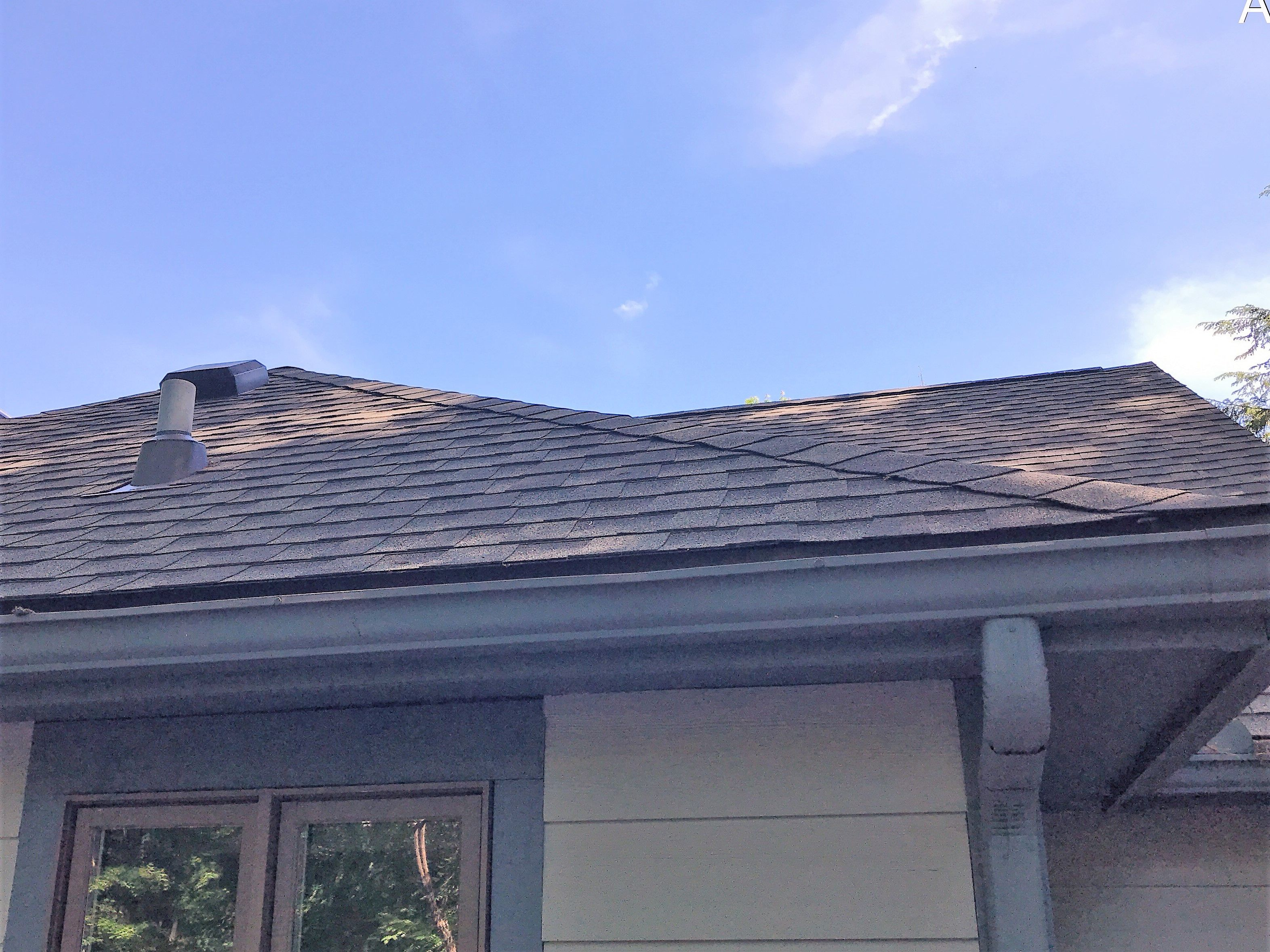 WInd Damaged Roof After Restoration